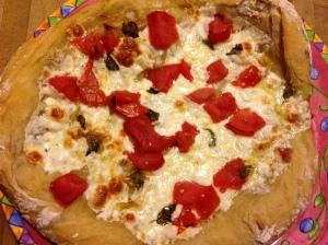 Fresh Jersey tomatoes, fresh basil, mozzarella, and sauteed onions and garilc