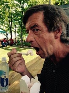 Husband eating strawberry ice cream.